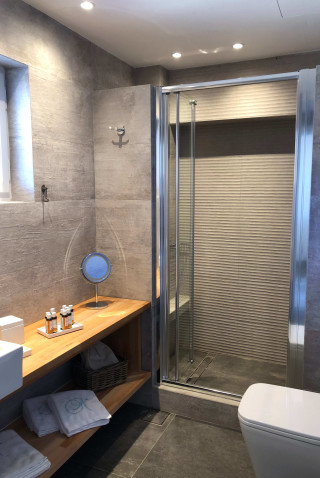 superior suite niriedes hotel shower